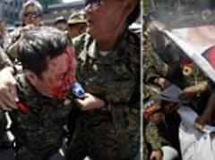 South Koreans burn Japanese flag in protest at mayor's defence of using their women as 'sex slaves' for army during WWII