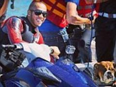 Lewis Hamilton and Roscoe on jet ski ahead of Monaco Grand Prix