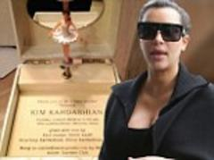 Kim Kardashian's baby shower invite... a ballerina music box complete with Kanye West lullaby