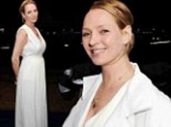 Uma Thurman beams in a bright white jumpsuit as she yacht party hops at Cannes Film Festival