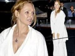 uma thurman wears a dressing gown as she party hops between yachts at cannes film festival