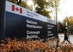 Ex Revenue Canada officials arrested in bribery scam
